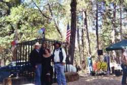 Son Travis, Cindy and Mike Shain at a fund raiser. 1800s Reanacting