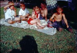 Picnic with the Reid (?) children. Those popsicles must have been cold.