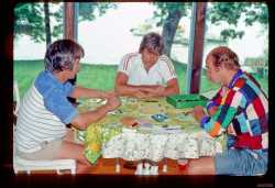 John and Gordon teaching John Shotwell to play Acquire. This was Gordon's and my all time favorite board game. We played for hours in the Stone Park days.